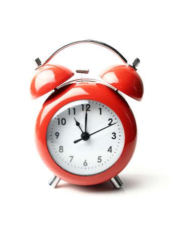 vintage retro red alarm clock 11 o'clock isolate white background