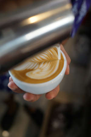 barista: coffee latte art make by barista