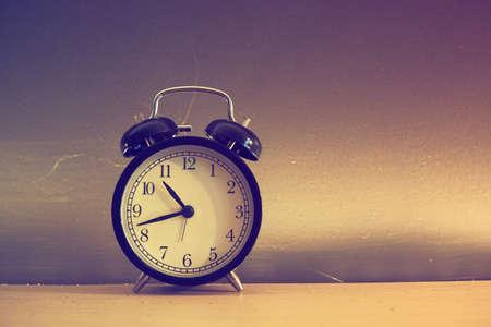 vintage alarm clock in vintage colo
