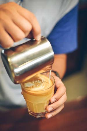 coffee latte art in coffee shop vintage color tone