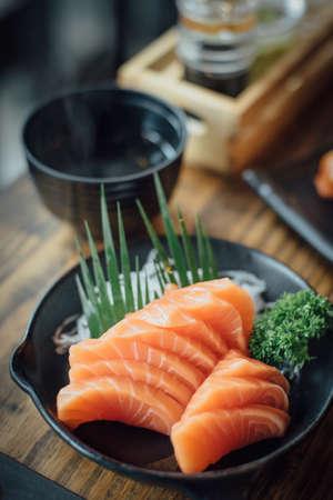 Salmon raw sashimi on wooden table