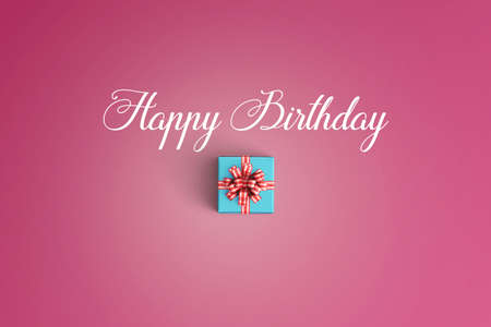 Happy birthday and gift box on color background 版權商用圖片