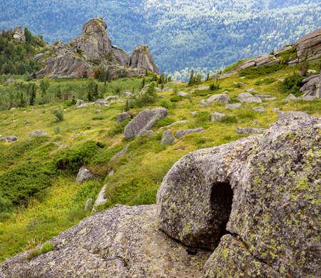 Unusual rocks in the mountains. Nature of mountain Sinyukha, the highest mountain Kolyvan ridge. Altai Krai, Russia. Stock Photo