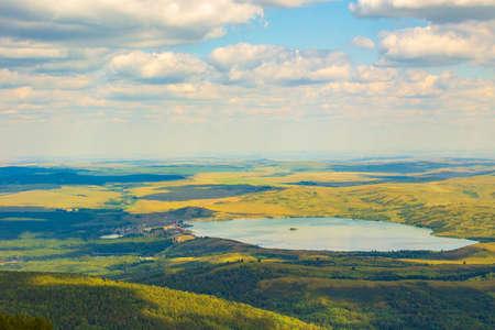 View of lake Beloe. Nature of mountain Sinyukha, the highest mountain Kolyvan ridge. Altai Krai, Russia.