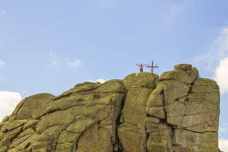 Cross on top of a mountain Sinyukha, the highest mountain Kolyvan ridge. Altai Region, Russia. Stock Photo