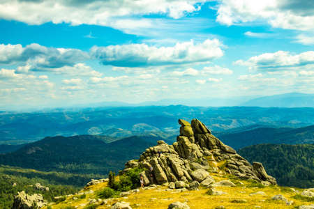 Unusual rocks in the mountains. Peak of mountain Sinyukha, the highest mountain Kolyvan ridge. Altai Krai, Russia.