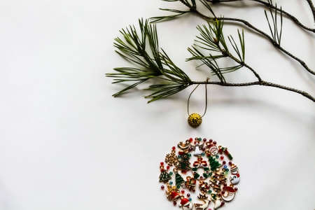 Christmas tree decorations formed from a small ornament of baubles on a white background