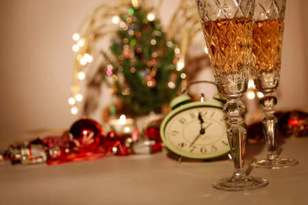 Champagne and new year decoration with christmas tree.