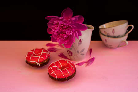 Flat photo with cups, strawberry donut and peony flower