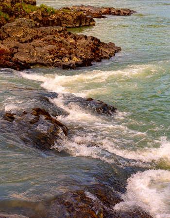 Stone rapids on a mountain river Katun Altai.