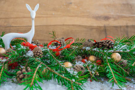 Christmas composition with fir branches, cones, berries and a toy