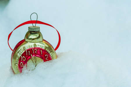 Retro clock Christmas toy in the snow
