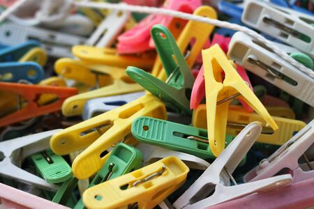 pegs: colorful clothes pegs piled up Stock Photo