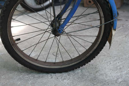 rear wheel: blue old bicycle rear wheel with other lower parts Stock Photo