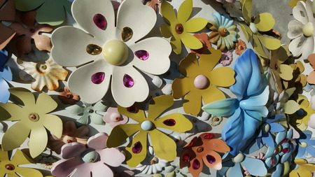 suface: colorful flower elements of sculpture suface with high contrast of daylight shadow cast Stock Photo