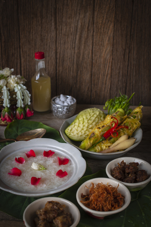 Khao-Chae, Cooked Rice Soaked in Iced Water in the white bowl and Eaten with the Usual Complementary Food and to decorate by flower, scented water.