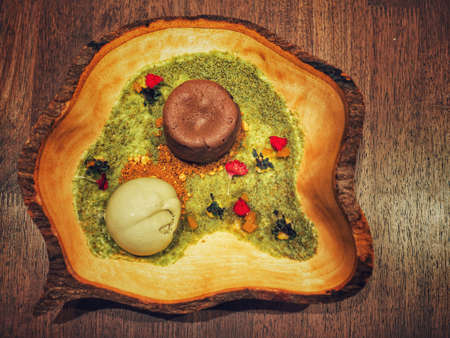 cold: chocolate lava cake with green tea ice cream decorate in garden theme Stock Photo