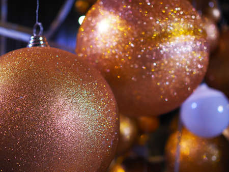Many Golden balls in Christmas Event . With blur background and have copy space to add your text.