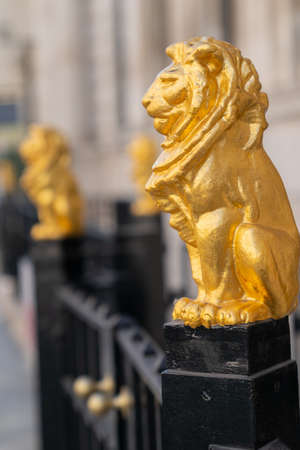 Gilded golden lions sitting on top of the metal railings outside the Law Society at Chancery Lane, London, England - 2 Editorial