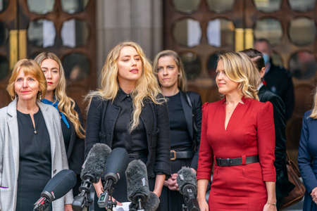 LONDON, ENGLAND - JULY 28, 2020: Amber Heard making a press statement outside the Royal Court of Justice in the Johnny Depp defamation libel Trial against The Sun Newspaper - 590