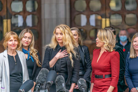 LONDON, ENGLAND - JULY 28, 2020: Amber Heard making a press statement outside the Royal Court of Justice in the Johnny Depp defamation libel Trial against The Sun Newspaper - 646