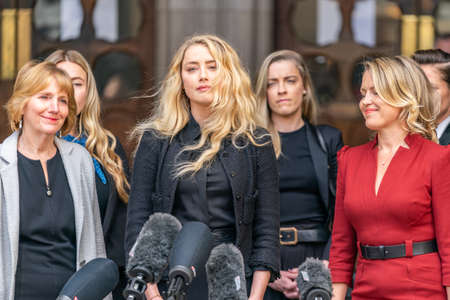 LONDON, ENGLAND - JULY 28, 2020: Amber Heard making a press statement outside the Royal Court of Justice in the Johnny Depp defamation libel Trial against The Sun Newspaper - 581