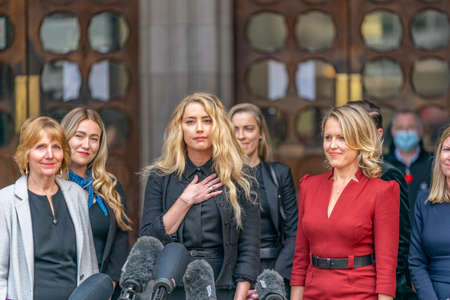LONDON, ENGLAND - JULY 28, 2020: Amber Heard making a press statement outside the Royal Court of Justice in the Johnny Depp defamation libel Trial against The Sun Newspaper - 641