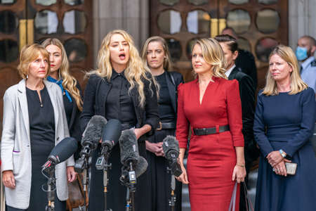 LONDON, ENGLAND - JULY 28, 2020: Amber Heard making a press statement outside the Royal Court of Justice in the Johnny Depp defamation libel Trial against The Sun Newspaper - 564