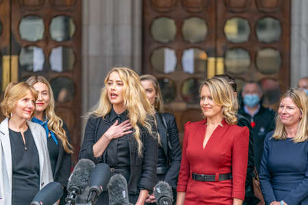 LONDON, ENGLAND - JULY 28, 2020: Amber Heard making a press statement outside the Royal Court of Justice in the Johnny Depp defamation libel Trial against The Sun Newspaper - 637