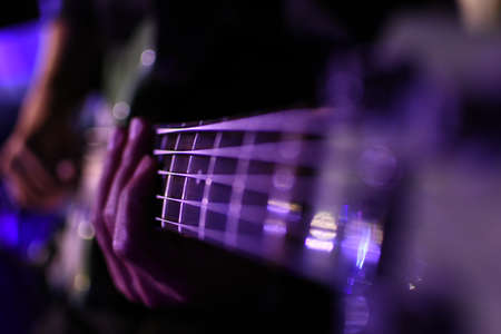 Bass player warms up backstage minutes before a show