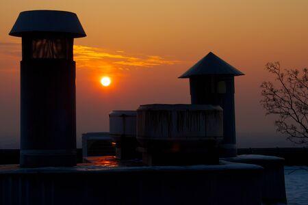 karlsruhe: Evening sun over Karlsruhe Turmberg, standing behind chimneys