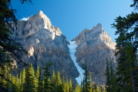 Two mountain tops and a glacier on Moraine Lake, Canada
