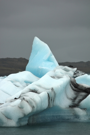 Iceberg against threatening sky at Jokulsarlon glacier lake in Iceland photo