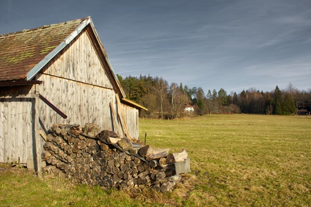 Old Barn on a Black Forest meadow, lighted by the evening sun Stock Photo