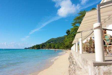Beach restaurant at the white beaches of Beau Vallon Bay, Mahe island, Seychelles
