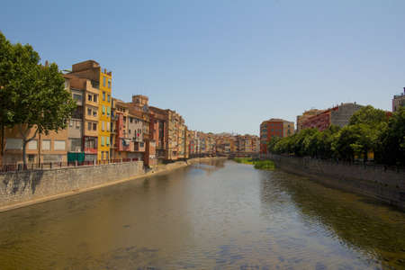 View of famous old city of Girona, or Gerona, with its river and old stone bridge