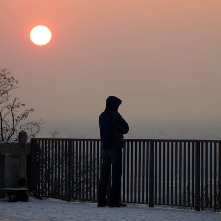karlsruhe: Lonely guy standing below a clear sunset, watching the scenery of Karlsruhe, Germany Stock Photo