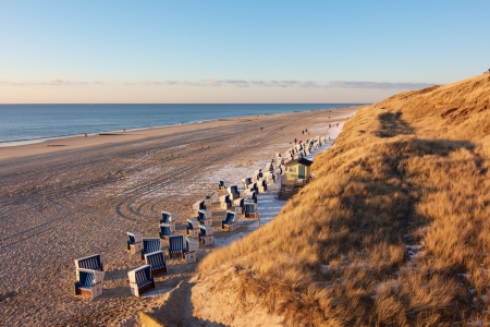 Quiet evening beach scene with typical beach chairs on Sylt island, Germany