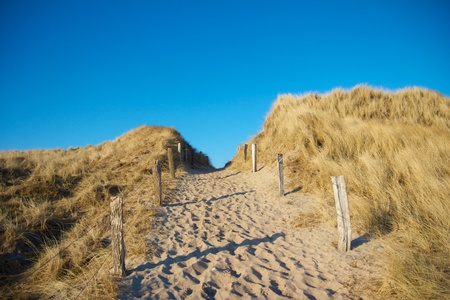 Sandy pathway between dunes leading towards the North Sea on Sylt island, Germany Stock Photo
