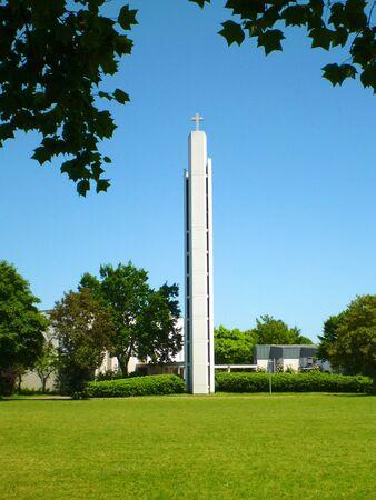 Modern church building and a meadow in Freiburg Seepark, Germany Standard-Bild