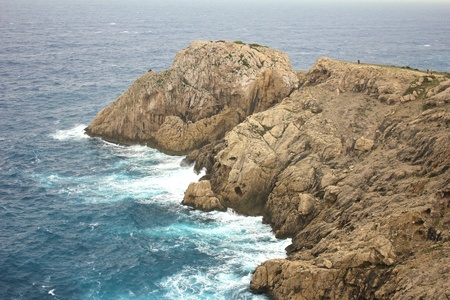 Rocky coast in the harsh Mediterranean Sea of Majorca island, Spain photo