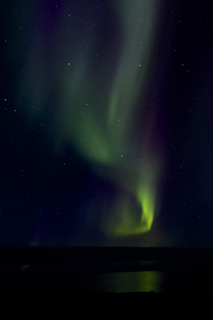 ionosphere: Amazing Aurora Borealis, or Northern Lights, at a sky full of stars at Hudson Bay, near Churchill, Manitoba, in summer