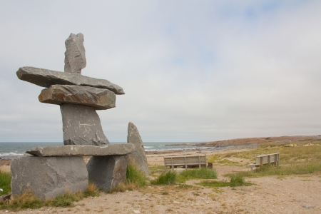 First Nations Inukshuk at the shores of Churchill, Manitoba, Canada Stock Photo
