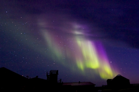 Amazing Aurora Borealis, or Northern Lights, at a sky full of stars at Hudson Bay, near Churchill, Manitoba, in summer