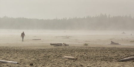 People in the fog on Long Beach, Vancouver Island, Canada photo