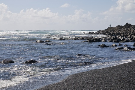 los hervideros: Black volcanic sand and lava rocks at the beach of Los Hervideros on Lanzarote island, Spain