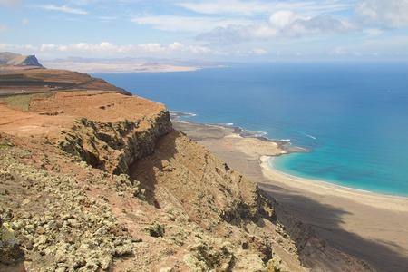 Amazing view on the volcanic coastline from Mirador del Rio vista, Lanzarote, Spain Stock Photo - 27931243