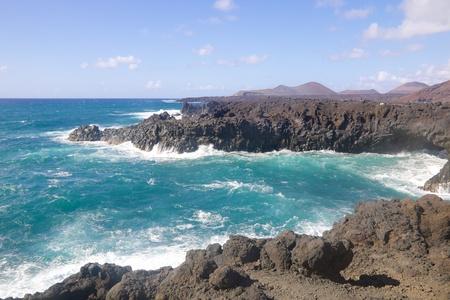 los hervideros: Black volcanic lava rocks at wild coastline of Los Hervideros on Lanzarote island, Spain