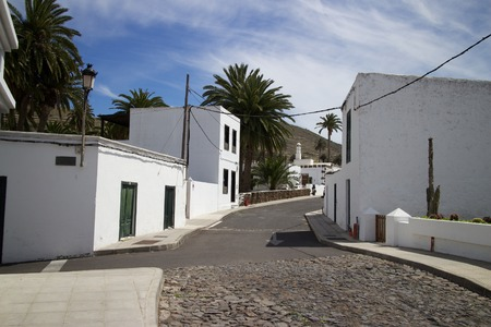 Typical lane between traditional houses in Teguise, Lanzarote island, Spain