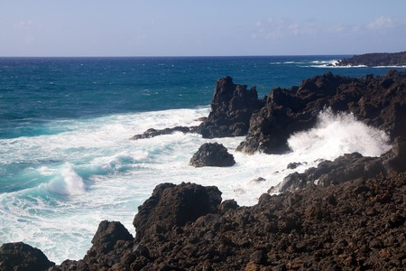 Wild sea and volcanic lava rocks at the Los Hervideros west coast of Lanzarote island, Spain Stock Photo - 28177690